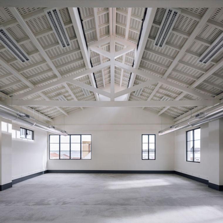 葡萄牙旧的四层锡工厂改建办公空间室内实景图16