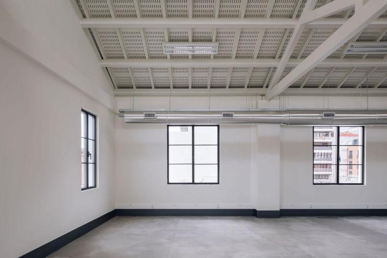 葡萄牙旧的四层锡工厂改建办公空间室内实景图17