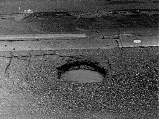 沥青及沥青混合料路用培训(298页)-沥青路面坑洞
