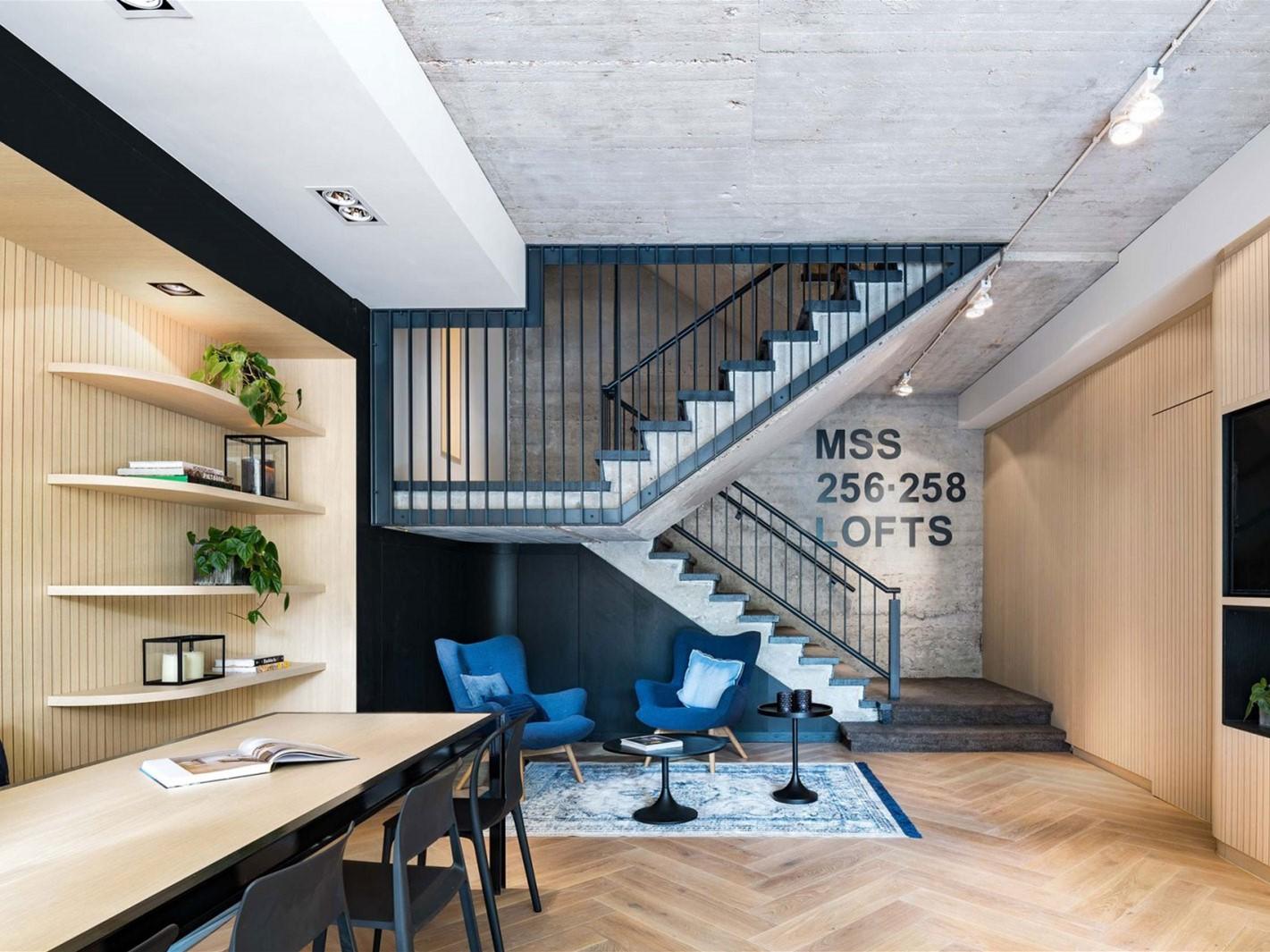 共有 12 种不同的楼中楼房型设计,室内均以原始混凝土天花板及壁面,水图片