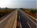 公路改建工程中沥青路面平整度的有效控制措施