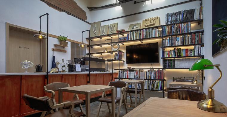 北京北海百年糖房改造-102-公共空间的咖啡图书区