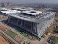 西部最大的会展综合体钢结构封顶 用钢量达18000吨