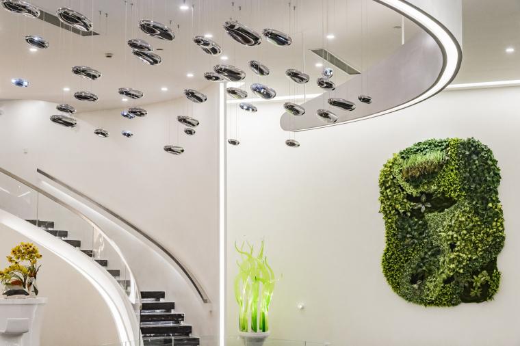 u形厨房装修效果图资料下载-[上海]上海多姆设计--时代广场商办展示中心实景效果图
