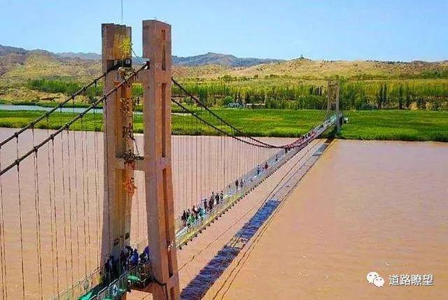 世界首座悬链桥——红旗峰玻璃桥开工建设_7